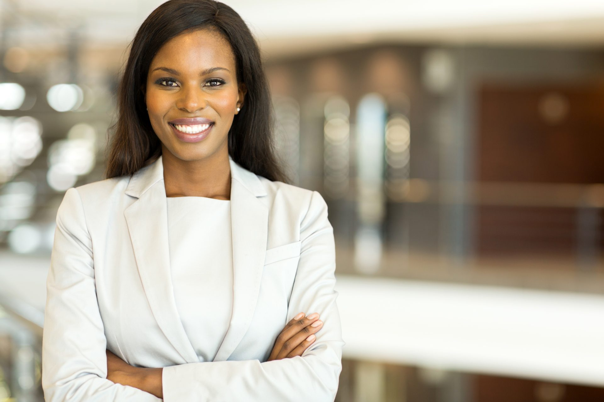 leading digital media agency Africa, attractive black business executive with arms crossed